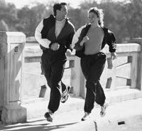 Photo of white male and white female jogging.