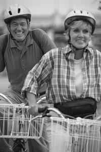 Photo of man and woman bicycling.