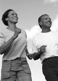 Photo of Black male and Black female jogging.