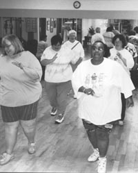 Photo of several large women walking in place.