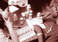 Image of doctor discussing medications with patient